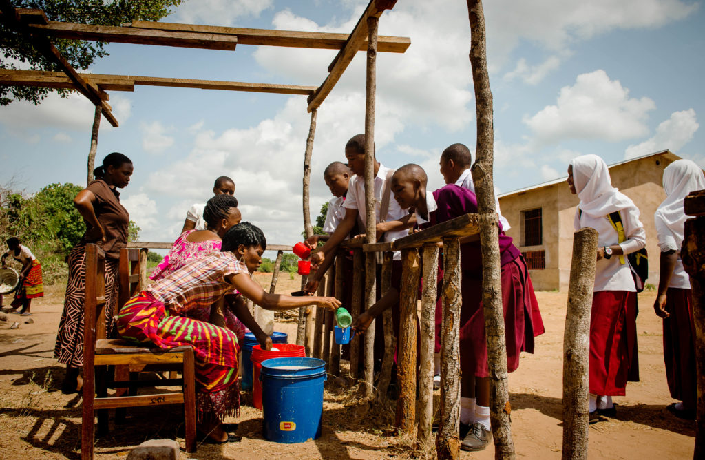Mothers at a rural school providing meals for marginalized students. Camfed/ Eliza Powell