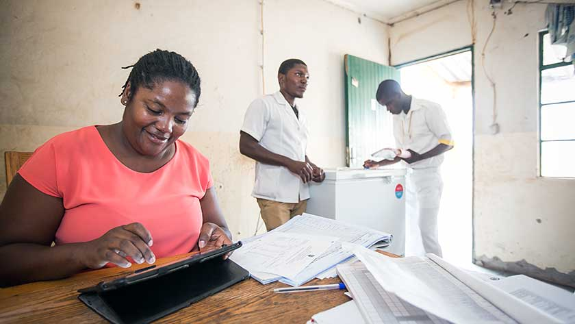 VillageReach health workers use OpenLMIS open source logistics management software in Mozambique to track health commodities.
