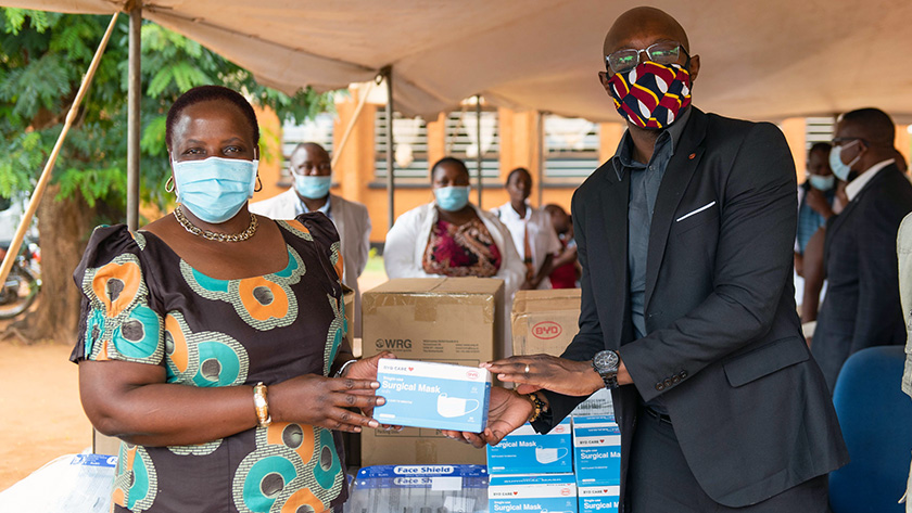 Malawi Minister of Health, Honorable Khumbize Kandodo Chiponda, MP formally receives PPE from Alinafe Kasiya, Malawi County Director, VillageReach, during handover ceremony at Chileka Health Center. Photo Credit: Homeline Media