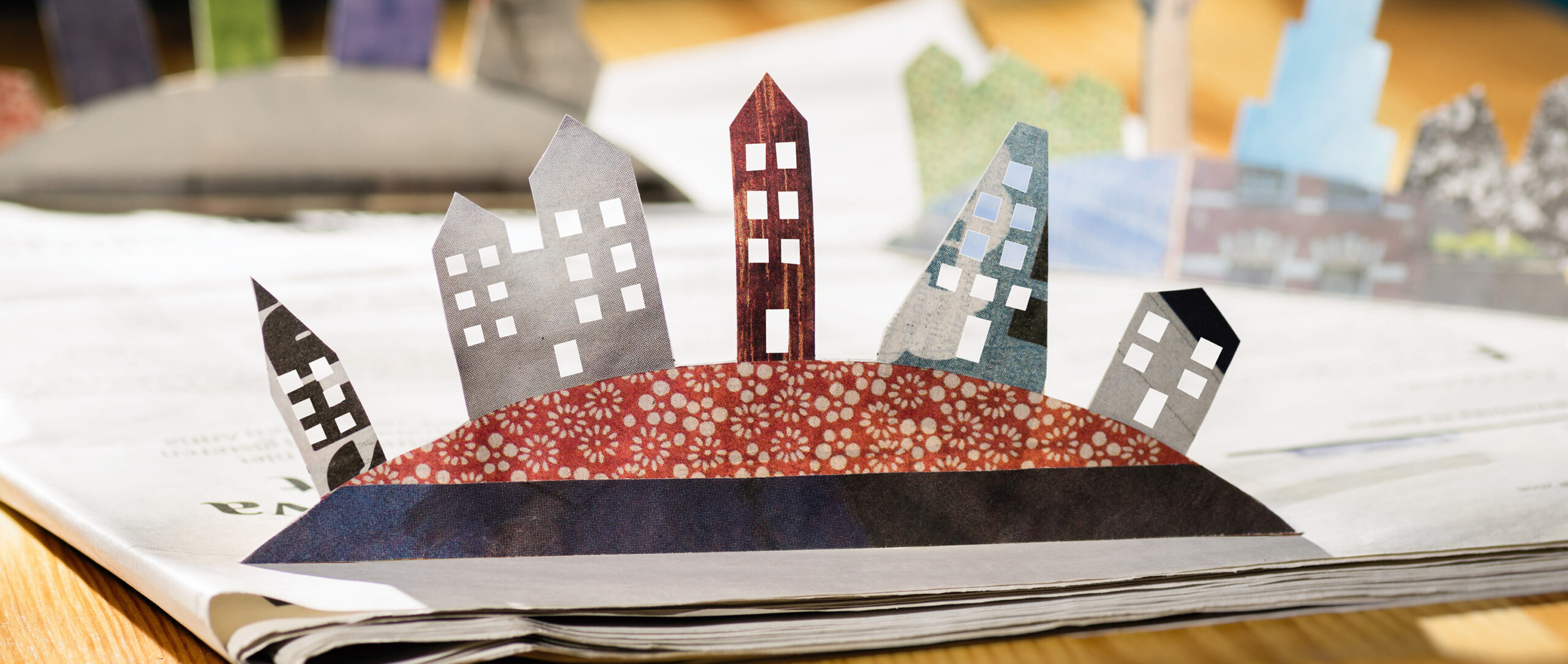 A photo illustration of a paper cutout of an urban street scene